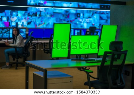 Modern surveilance control room and computer CCTV monitors. #1584370339