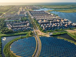Modern sustainable neighbourhood in Almere, The Netherlands. The city heating (stadswarmte) in the district is partially powered by a solar panel island (Zoneiland). Aerial view.