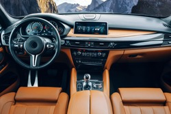 Modern suv car interior with leather panel, multimedia and dashboard
