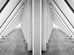 Modern symmetric tunnel in futuristic interior with concrete arches in perspective