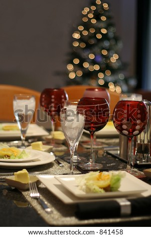 Modern tableware with Christmas tree in background