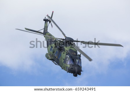 Modern tactical helicopter flying close. The chopper is filled with new technology for tactical warfare.
