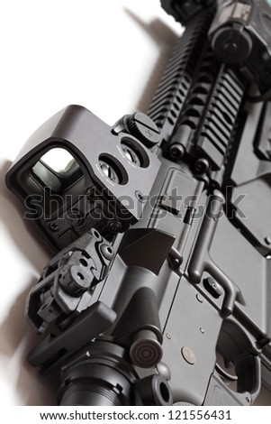 Modern tactical laser sght on an assault carbine close-up. Modern weapon series.