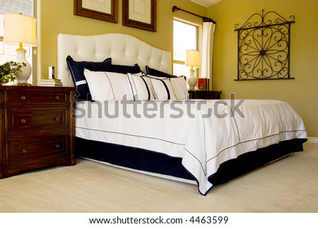 Modern tastefully decorated master bedroom - stock photo
