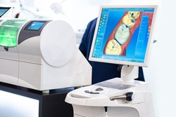 Modern technologies in dental industry. Digital dentistry concept. Digital scan of human teeth. Result is displayed on a blue screen. Equipment for dentistry. Prosthetics at dental industry