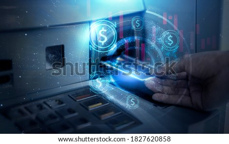 Modern technology banking money financial management saving funds inserting credit card into ATM machine withdrawing cash, bank account information transaction transfer, futuristic graphics and icon Foto stock ©