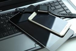 Modern technology, gadgets: smart clock, smartphone, tablet, laptop.