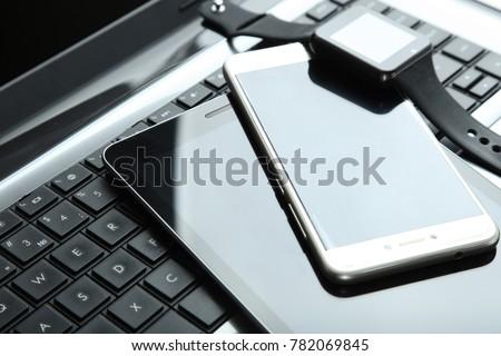 Modern technology, gadgets: smart clock, smartphone, tablet, laptop. #782069845