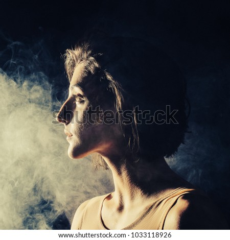 free photos female portrait with side lighting and smoke avopix com