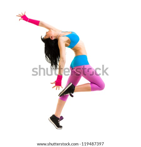 Modern teenage girl dancer jumping against isolated on a white background