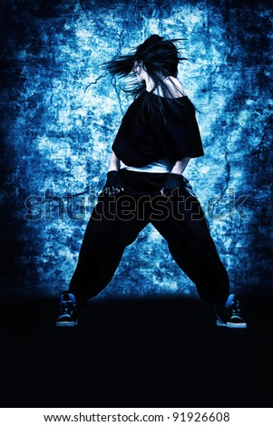 Modern teenage girl dancing hip-hop at studio.