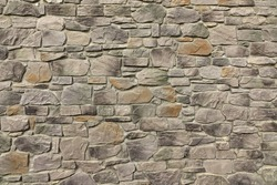 Modern Textured Grey Yellow Stonewall Made From Flagstone And Sandstone Slabs Background, Bumpy Stone Wall Texture, Rocky Structure Backdrop