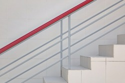 Modern Tiled Staircase Or Stairway With Iron Guard Hand Railing At The White Wall Background. Side View. Selective Focus.