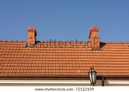 Modern tiles roof against the blue sky.