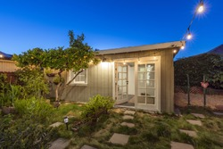 Modern Tiny Home Guest House at twilight.