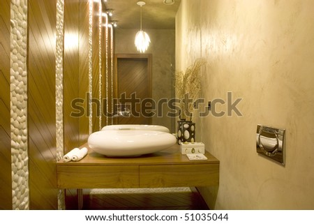 modern toilet with big mirror