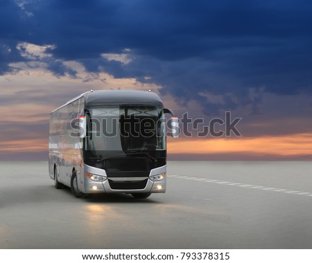 modern tourist bus on asphalt in the evening on sunset