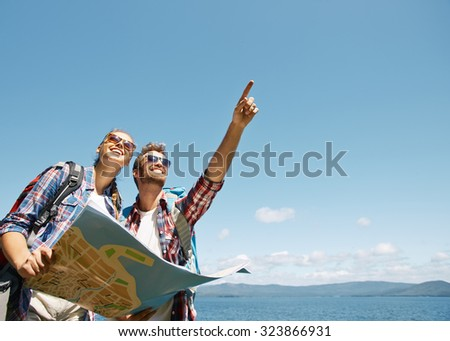 Shutterstock Modern tourists with map looking where to go next