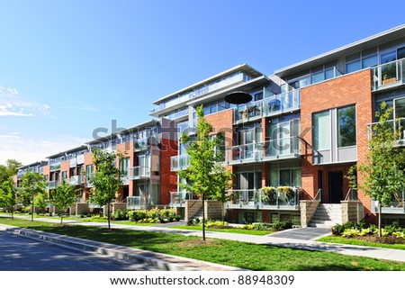 Modern town houses of brick and glass on urban street #88948309
