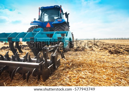 modern tractor in a field on a...
