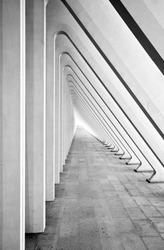 Modern tunnel in futuristic interior with concrete arches in perspective