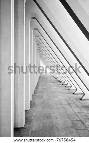 Modern tunnel in futuristic interior with concrete arches in perspective