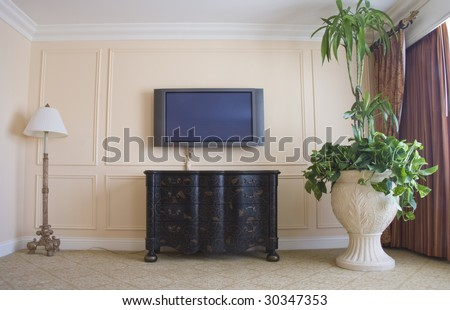 Modern TV home theater in room with classic furniture