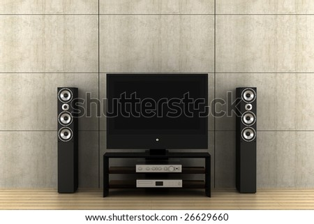 modern tv with speakers in front of gray wall