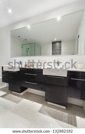 Modern twin bathroom in stylish Australian apartment
