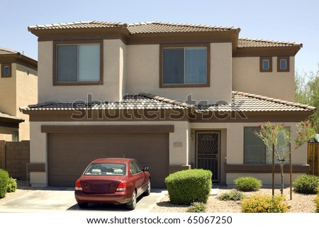 Modern two-story single family house with garage and car in driveway