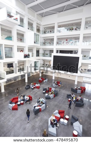 Modern university lobby atrium and study rooms, vertical stock photo