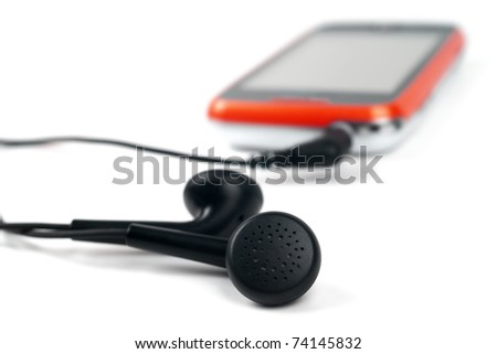Modern unrecognizable mobile phone - touchphone with connected headphones isolated on white - stock photo