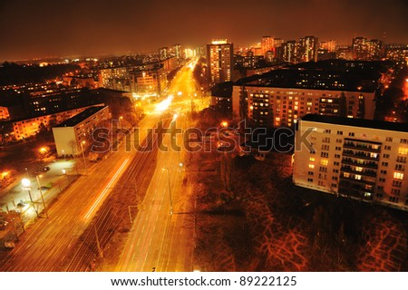 Modern Urban City at Night with Freeway Traffic - stock photo