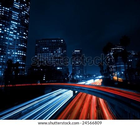Modern Urban City with Freeway Traffic at Night, Dark City Skyline, Down Town Los Angeles