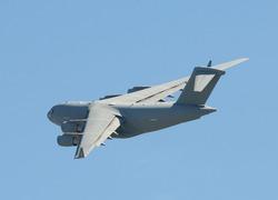 Modern US military cargo jet in flight