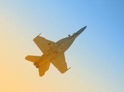 Modern US Navy fighter jet in morning sunshine