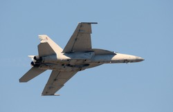 Modern US Navy jet fighter flying at high speed