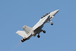 Modern US Navy jet fighter taking off with lots of power