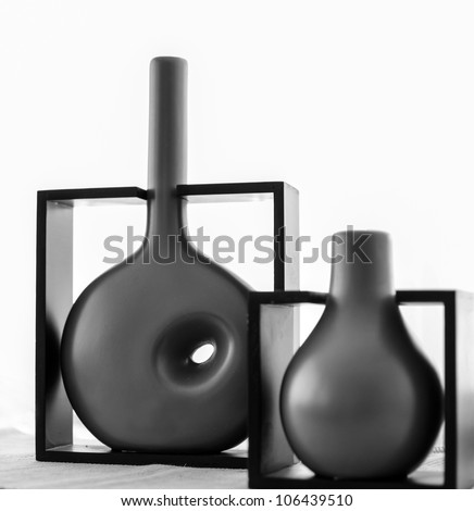 Modern vases on shelf