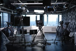 Modern video recording studio with professional cameras