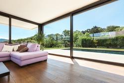 Modern villa, interior, wide living room with pink divan
