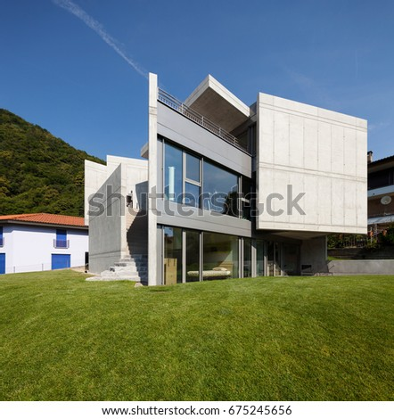modern villa surrounded by...