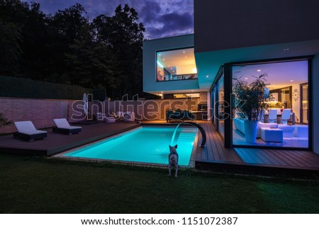 Modern villa with colored led lights at night. Nobody inside #1151072387