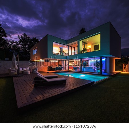 Modern villa with colored led lights at night. Nobody inside #1151072396