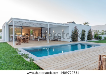 Modern villa with pool and deck with interior