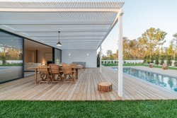 Modern villa with pool and deck with interior view