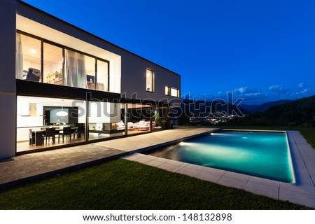 Modern villa with pool night scene