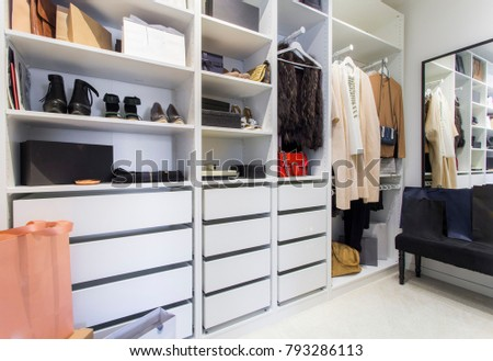 Modern walk in closet with luxury shoes and bags #793286113
