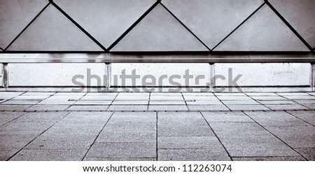 Modern wall and paving stones in dramatic black and white