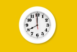 Modern wall clock white isolated on yellow background, time and period, office timepiece and mockup with hour and minute, hour hand, object classic.